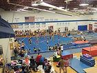 Large gymnasium, decal gymnastics, project graduation, gymnastics competition, gymnastics meet, gymnastics classes, mats, apparatus