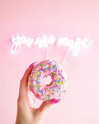 Canva - Woman Holding Donut with Sprinkl