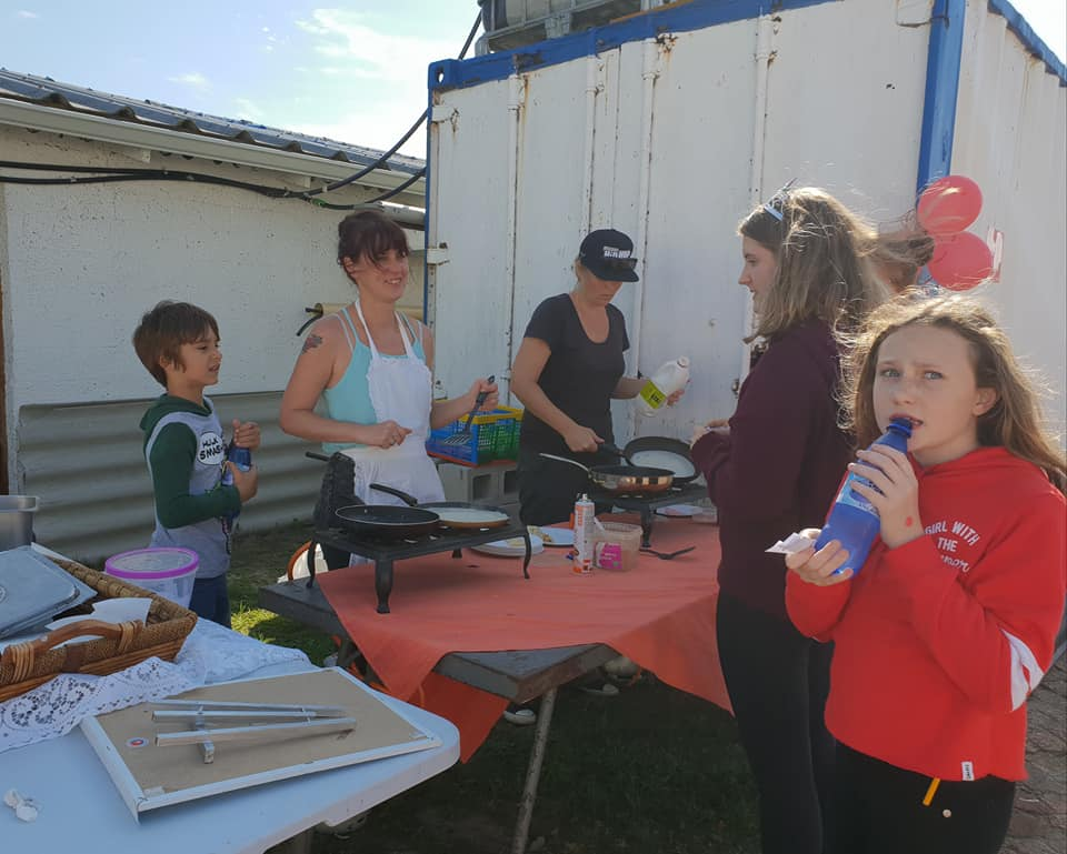 Cub moms cooking up a storm at the very popular pancake stall.