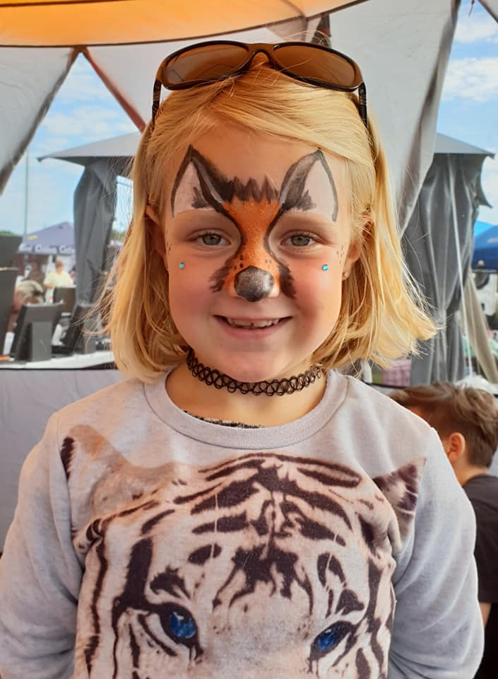 Cub Amy gets her face painted.