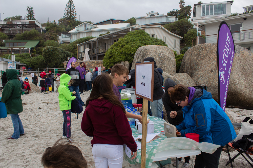 The tuckshop volunteers toughing it out against the elements.