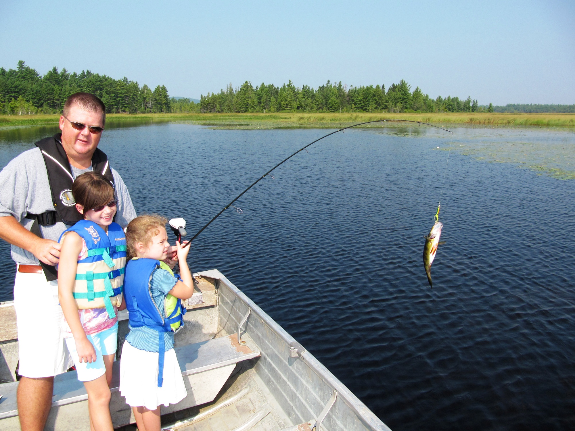 Family fishing on Pocomoonshine Lake