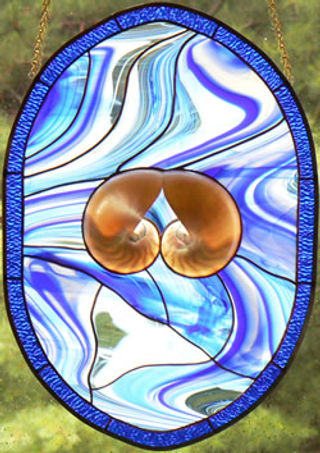 Stained glass panel with nautilus shell by Wrenovations