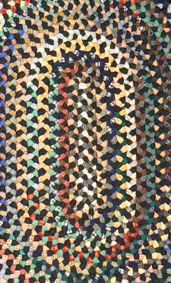 Oval braided wool rug