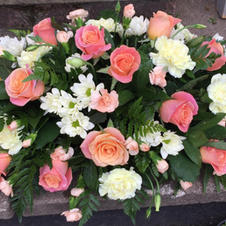 Peach and cream rose spray from £50