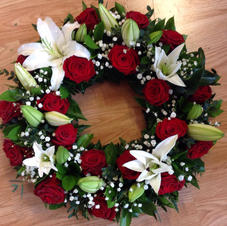 Red rose and lily wreath from £45