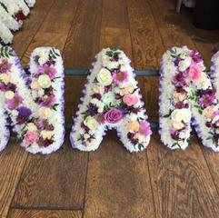 Full flowered lettering £55 per letter