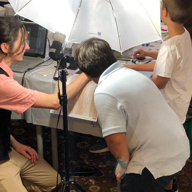 A scene unfolds before young animators' eyes, from one of my weekly classes. (That's me, in the vest.)