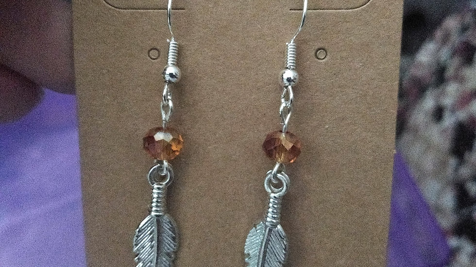 feather dangles with peach glass bead