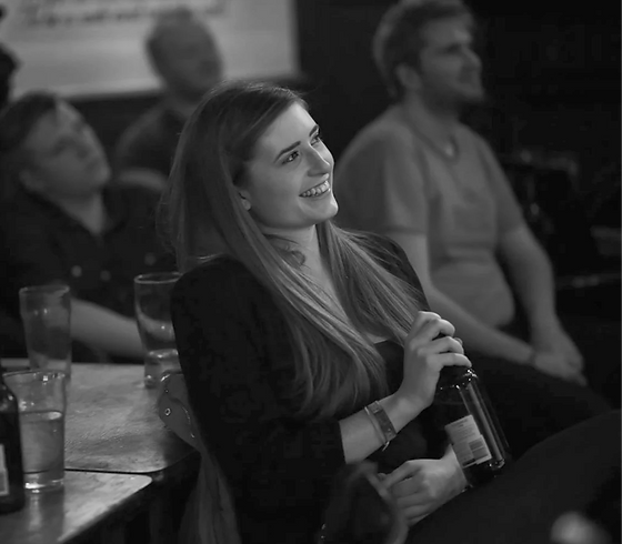 Black and White Smiling Woman Bottle Audience