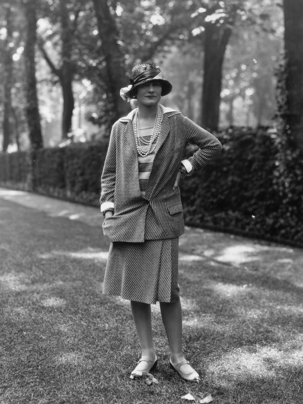 Coco Chanel wearing one of her first production suits