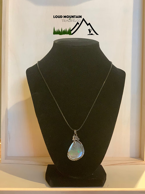 Ethiopian Opal Wrapped In Sterling Silver Pendant
