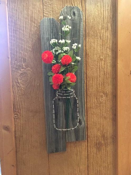 String Jar With Orange Carnations On Barnwood