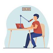 Radio host speaking at microphone at laptop.jpg