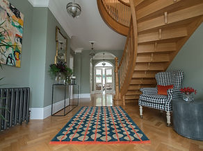 Contemporary entrance hall, stairs, patterned rug, entrance hall with character