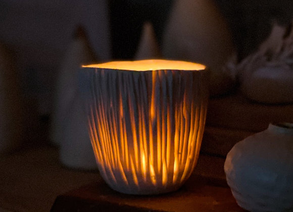 Luminescent porcelain handcarved tea light candle holder