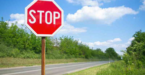 Security cameras and stop sign installed at campus entrance
