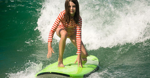 Young%20Girl%20Surfing%20Pacific%20Ocean