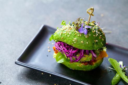 Avocado sandwich with green vegan burger