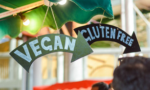 'Vegan' and 'Gluten Free' signs pointing