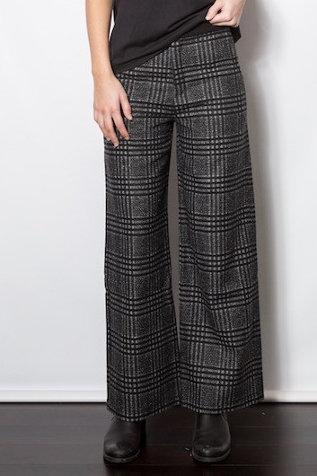 33843b352a Add the illusion of length to your legs with these high waisted wool  trousers in charcoal and black plaid. Classic with a taste of edge.