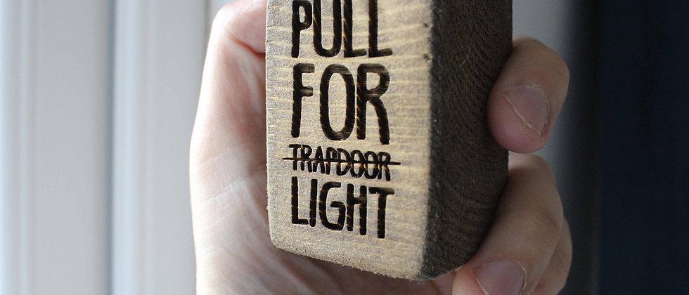 Trapdoor Light Pull