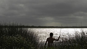 4k young man fishing in lake at dusk-ts1