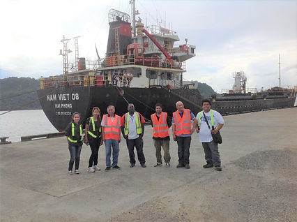Seagate Philippines team infront of a cargo ship carrying rice for the Bougainville POGE program