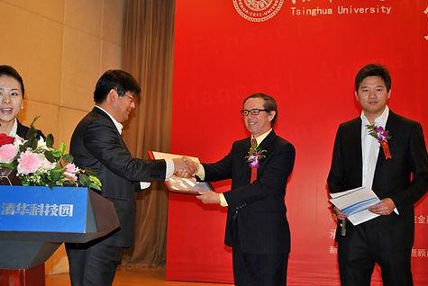 Willam Lawton receiving an award at Tsighua Universiy in Bejing, China