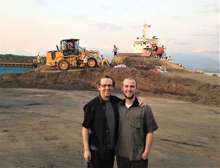 William Lawton with his son, Will Lawton, loading iron ore bound for China from Zambales, Philippines