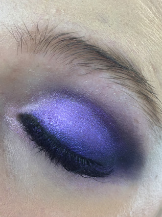 colorful smokey eyes by using violet deep purple and lilac glitter in the middle of the eyelid