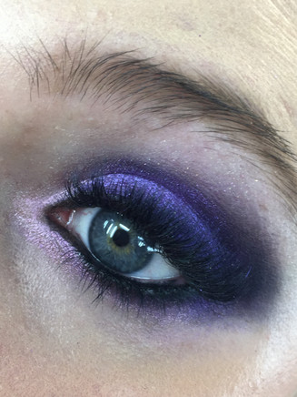 colorful smokey eyes by using violet deep purple and lavender in the inner corner of the eyes