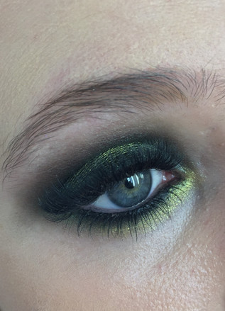 colorful smokey eyes with blackish green and light olive yellow in the middle
