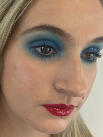 inspired by 1970s contemporary fashion makeup to focus on the eyes and lips makeup