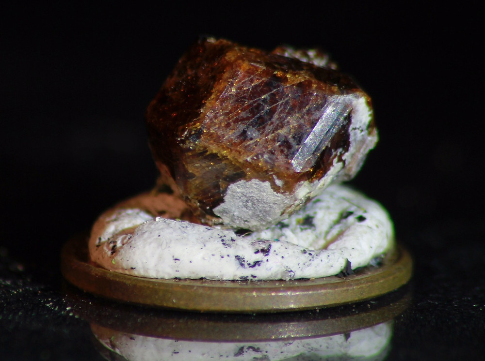 Figure 1: An almandine Garnet. Photo credit to Zach Capel.