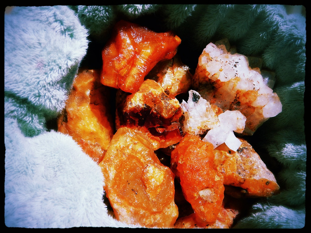 Figure 1: Carnelian agates found in Cowlitz County, WA and quartz crystals and sheet from outside Tenino, WA.