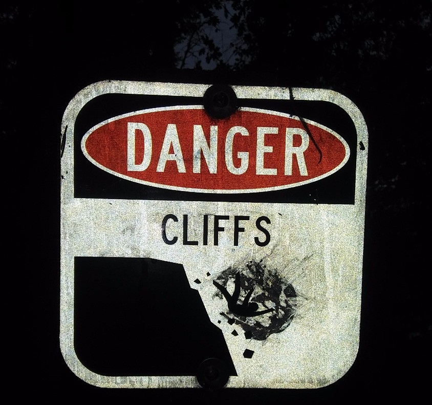 "Figure 6: Hilarious ""Cliff Warning"" sign at Point Definace Park. Reminding us that the road of life is filled with spontaneous things that may plummet you to your death."