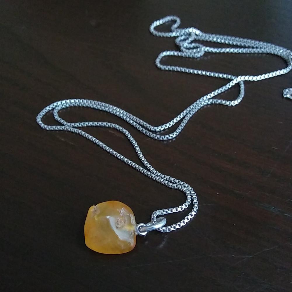 Figure 3: Carnelian agate pendant on an heirloom boxchain.