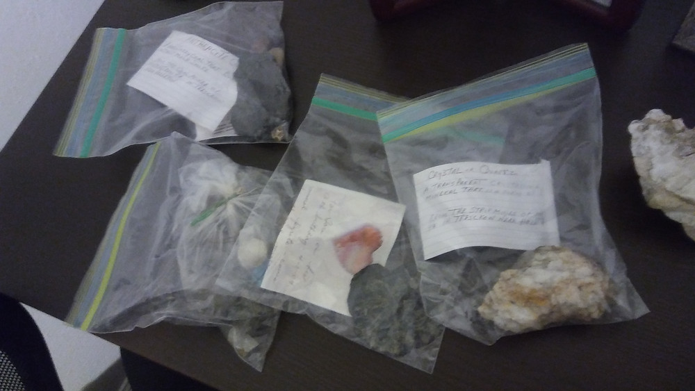 Figure 6: Baggies with samples and identifying note cards, written in Grandma Betty's slanting penmanship.