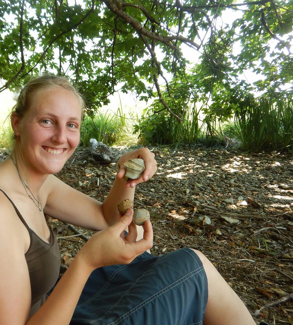 Figure 6: Bristol Underwood holding up some vertebrate fossils she found in Knappton, WA.
