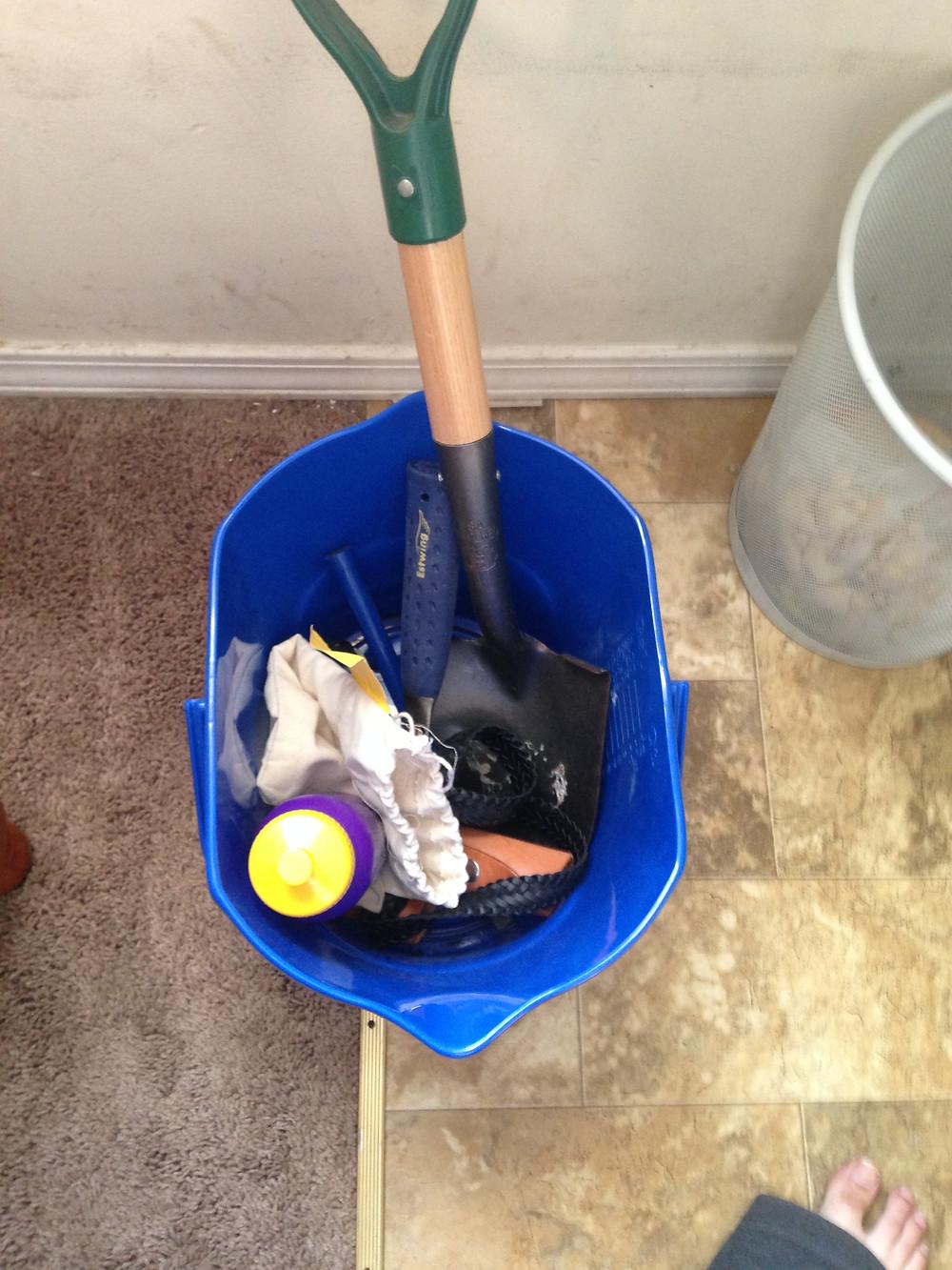 Figure 3: Rock/mason hammer, bucket, and collection bag. Your basic hounding set up prep!