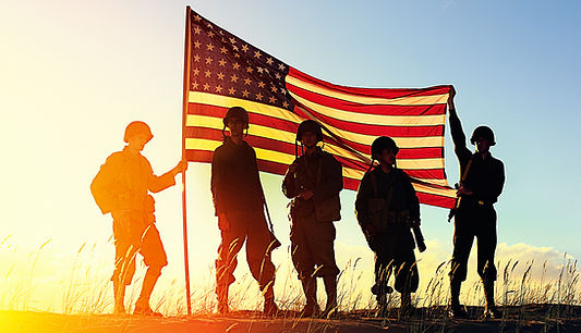 Veterans standing in front of the flag