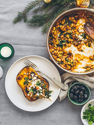 Stuffed pumpkin with tomato beans, spinach and raisins