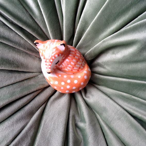 foxi-on-round-cushion.jpg