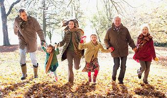 Family running through woods
