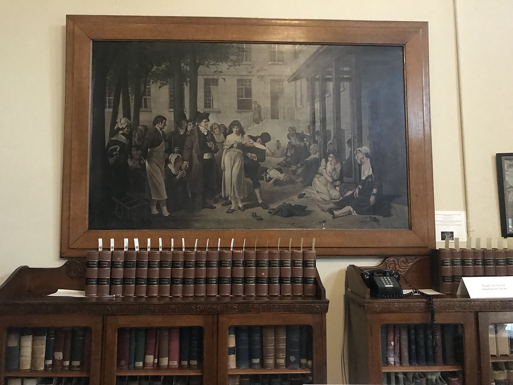 """A copy of Tony Robert-Fleury's painting """"Pinel Freeing the Insane"""" hanging in an office at the Central State Hospital in Indiana"""