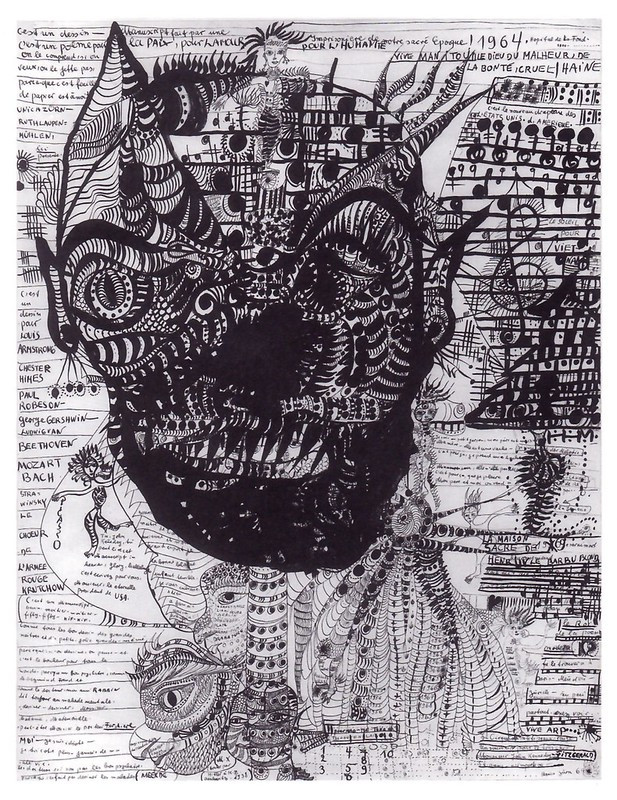 In the center is a large, grotesque head with striped designed throughout and some musical notations. Around the head are small doodles, musical notes, and many scribbled/hard to read words crowding around. The whole scene is chaotic and filled with dark ink lines.