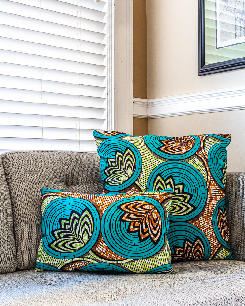 Green and brown lotus flowers on African print decorative pillows