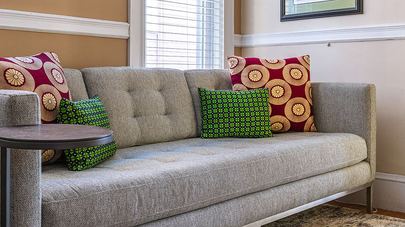 Diamonds and Rose Window African print throw pillow covers on neutral sofa
