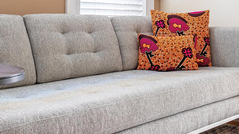 Lara Threads African print decorative pillows on gray sofa